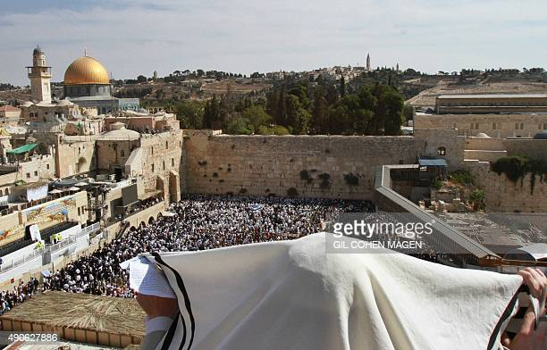 A Jewish worshipper draped in a prayer shawl performs the annual Cohanim prayer during the Sukkot or the feast of the Tabernacles holiday at the...