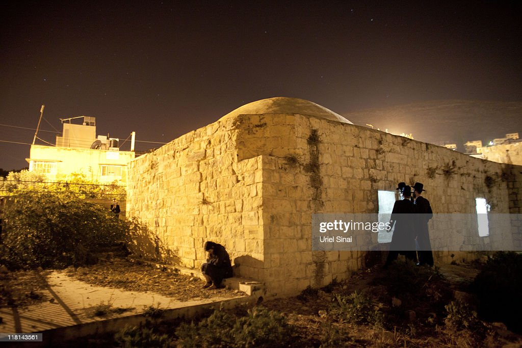 Jewish worshippers pray outside Joseph's Tomb as hundreds of faithful mark the anniversary of the biblical Joseph's death on July 4 2011 in Nablus...