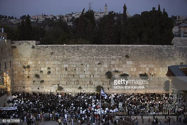 Jewish worshippers welcome the Shabbat Hebrew for Sabbath a day of religious observance and abstinence from work kept by Jews from Friday evening to...