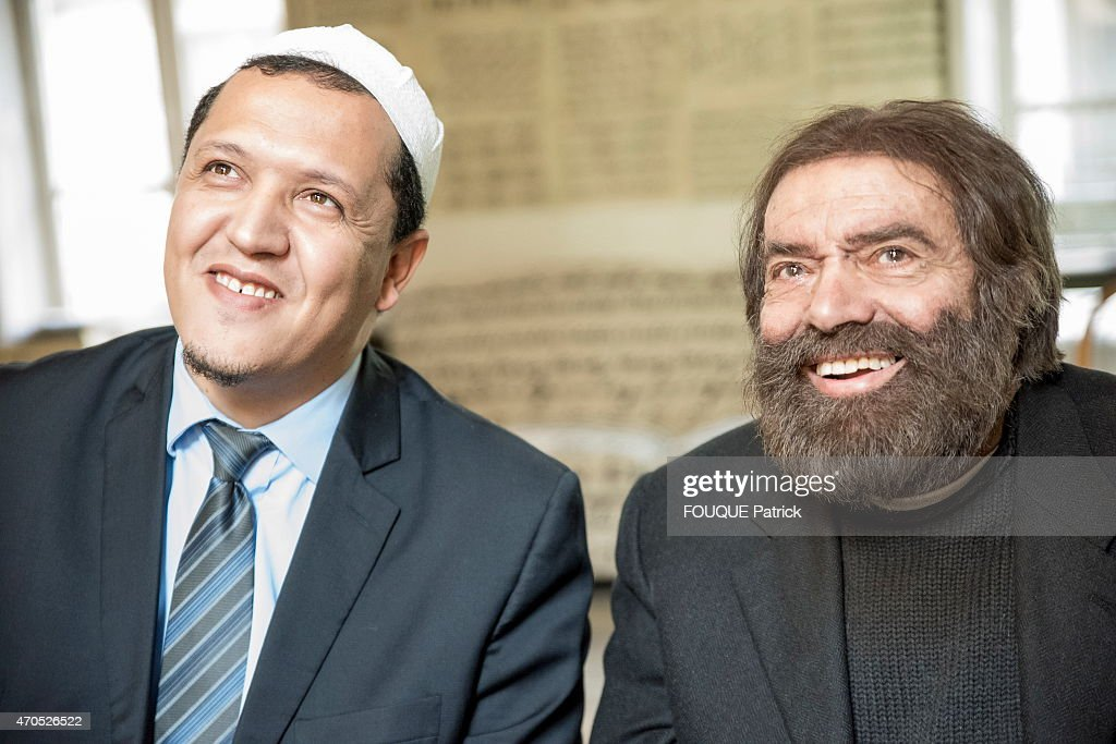 Jewish writer <a gi-track='captionPersonalityLinkClicked' href=/galleries/search?phrase=Marek+Halter&family=editorial&specificpeople=768328 ng-click='$event.stopPropagation()'>Marek Halter</a> and muslim Hassen Chalghoumi, iman of the mosque of Drancy at <a gi-track='captionPersonalityLinkClicked' href=/galleries/search?phrase=Marek+Halter&family=editorial&specificpeople=768328 ng-click='$event.stopPropagation()'>Marek Halter</a>'s home in Paris on February 11, 2015. the furniture in the room is covered with the word peace in all languages.