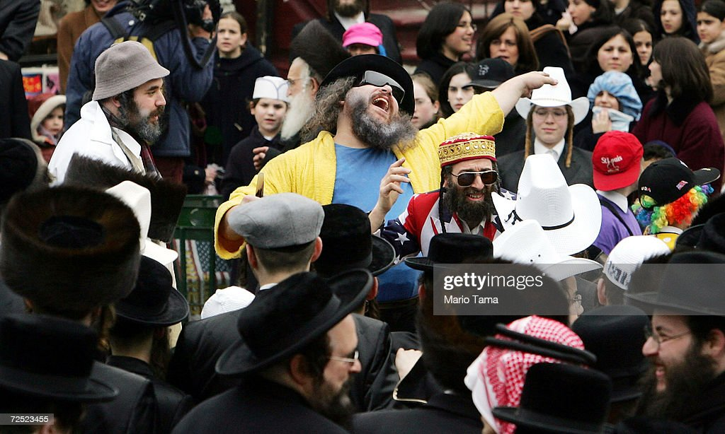 Jews dance in costumes and cowboy hats during Purim festivities in the Williamsburg section of Brooklyn March 25 2005 in New York City Festivities...