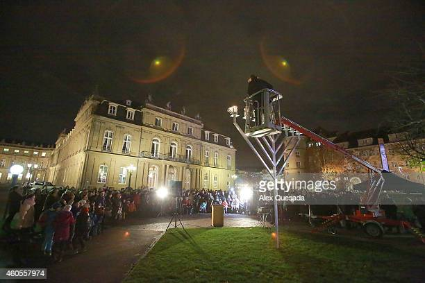 Jews gather in front of the Neues Schloss for the lighting of the Menorah on the first night of Hanukkah on December 16 2014 in Stuttgart Germany...
