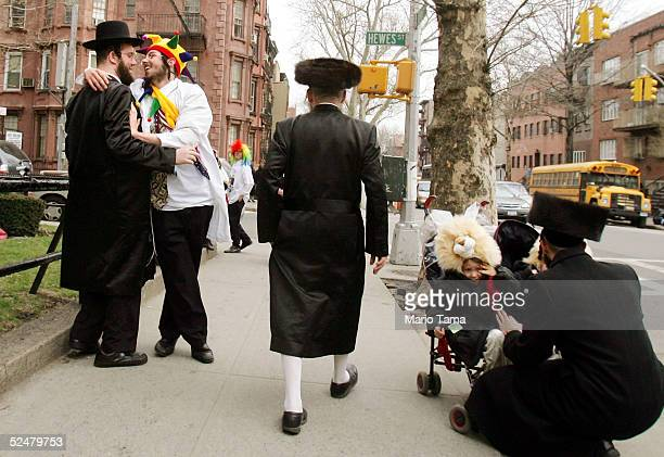 Jews greet one another on the street during Purim festivities in the Williamsburg section of Brooklyn March 25 2005 in New York City Festivities for...