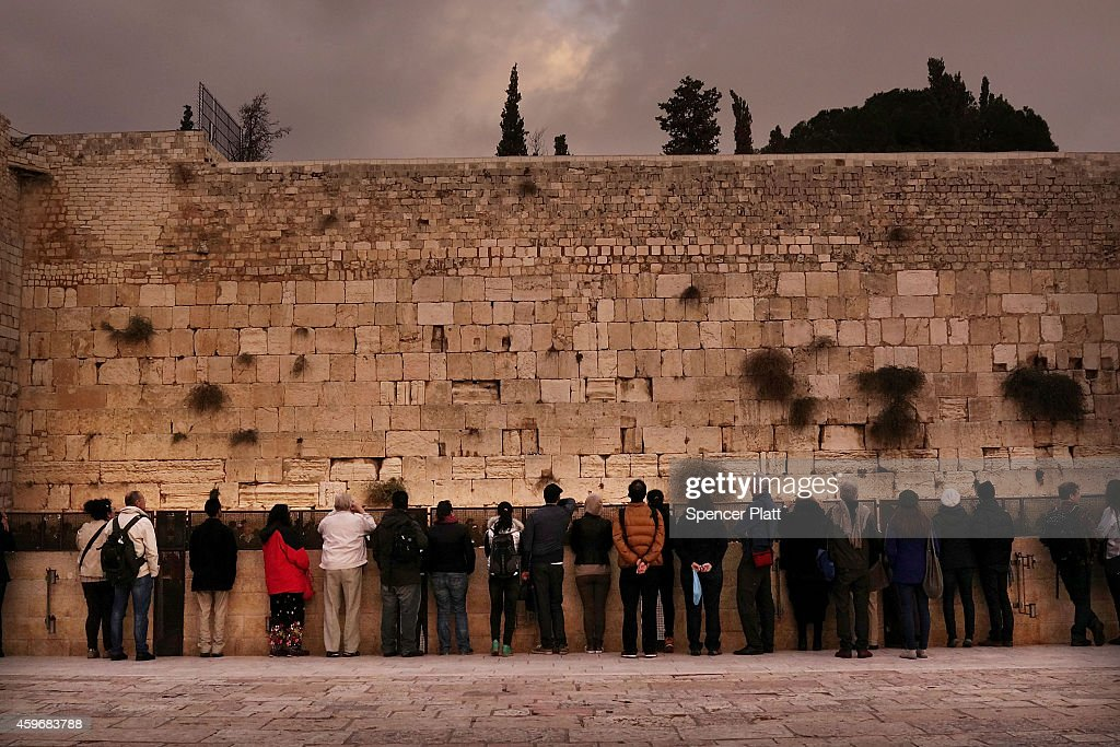 Jews pray at the Western Wall during Shabbat the Jewish day of rest and seventh day of the week in Jerusalem on November 28 2014 in Jerusalem Israel...