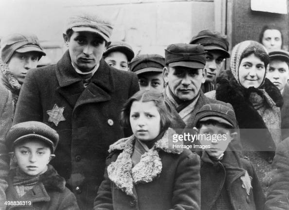 Jews wearing Star of David badges Lodz Ghetto Poland World War II 19401944 The Nazis forced Jews into overcrowded ghettos from which thousands were...