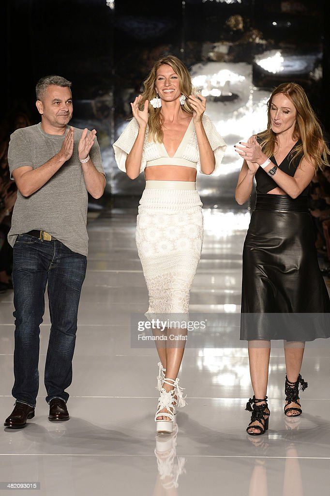 Jeziel Moraes,<a gi-track='captionPersonalityLinkClicked' href=/galleries/search?phrase=Gisele+Bundchen&family=editorial&specificpeople=201815 ng-click='$event.stopPropagation()'>Gisele Bundchen</a> and Adriana Zucco walk during the Colcci show at Sao Paulo Fashion Week Summer 2014/2015 at Parque Candido Portinari on April 2, 2014 in Sao Paulo, Brazil.