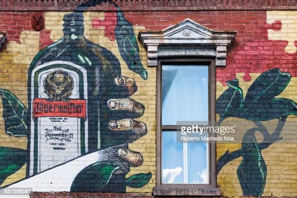 Jägermeister old grafitti mural as product placement in heritage building in Queen Street West The Victorian architecture red brick landmark is...