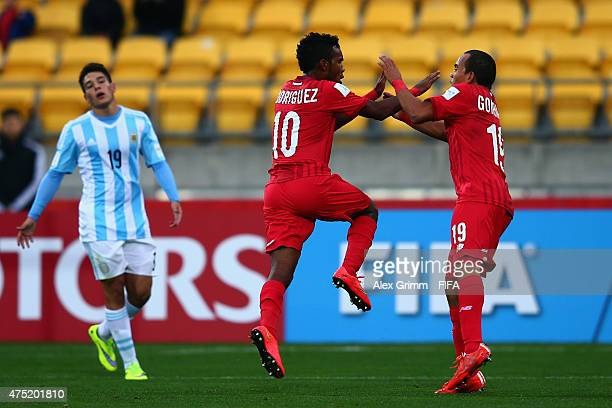 Jhamal Rodriguez of Panama celebrates his team's first goal with team mate Jesus Gonzalez as Emiliano Buendia of Argentina reacts during the FIFA U20...