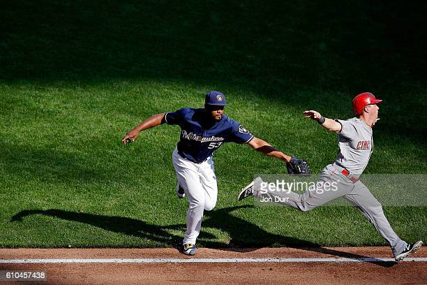 Jhan Marinez of the Milwaukee Brewers tags out Tony Renda of the Cincinnati Reds during the seventh inning at Miller Park on September 25 2016 in...