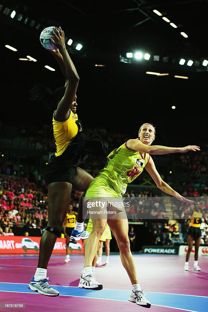 Jhaniele Fowler of Jamaica competes with Demelza McCloud of Australia during the semi final match between Jamaica and Australia on day three of the Fast5 Netball World Series at Vector Arena on November 10, 2013 in Auckland, New Zealand.