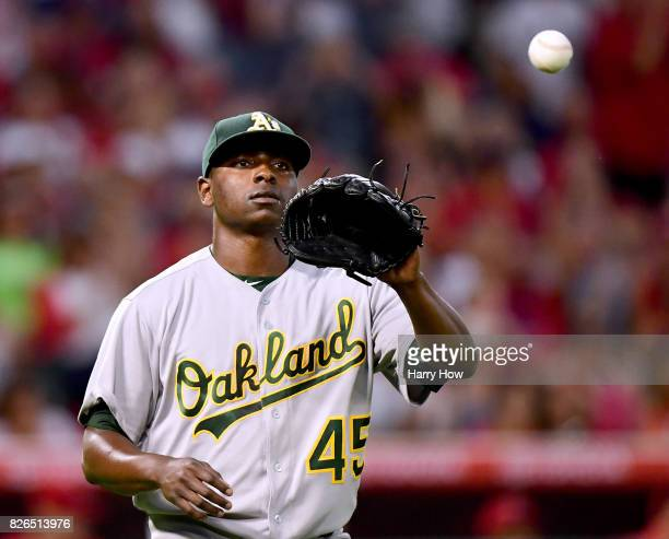 Jharel Cotton of the Oakland Athletics reacts after a fielding error which allowed Andrelton Simmons of the Los Angeles Angels to score during the...