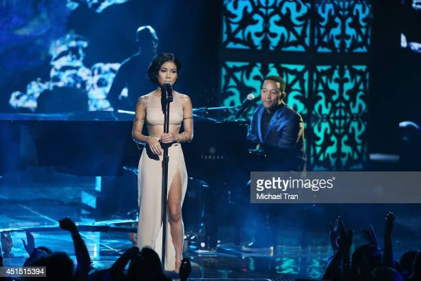 Jhene Aiko and John Legend perform onstage during the 'BET AWARDS' 14 held at Nokia Theater LA LIVE on June 29 2014 in Los Angeles California