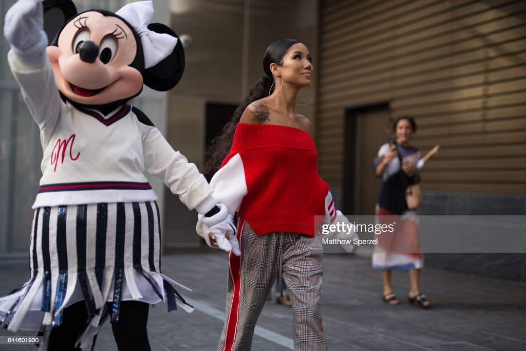 Jhene Aiko and Minnie Mouse are seen attending Monse during New York Fashion Week wearing a red sweater on September 8, 2017 in New York City.