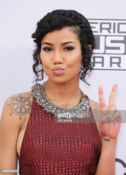 Jhene Aiko attends the 2014 American Music Awards at Nokia Theatre LA Live on November 23 2014 in Los Angeles California