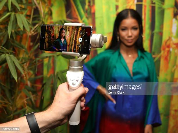 Jhene Aiko poses for a video on a Samsung Galaxy Note 8 during her a TRIP launch party powered by Samsung at EB Gallery on September 22 2017 in Los...