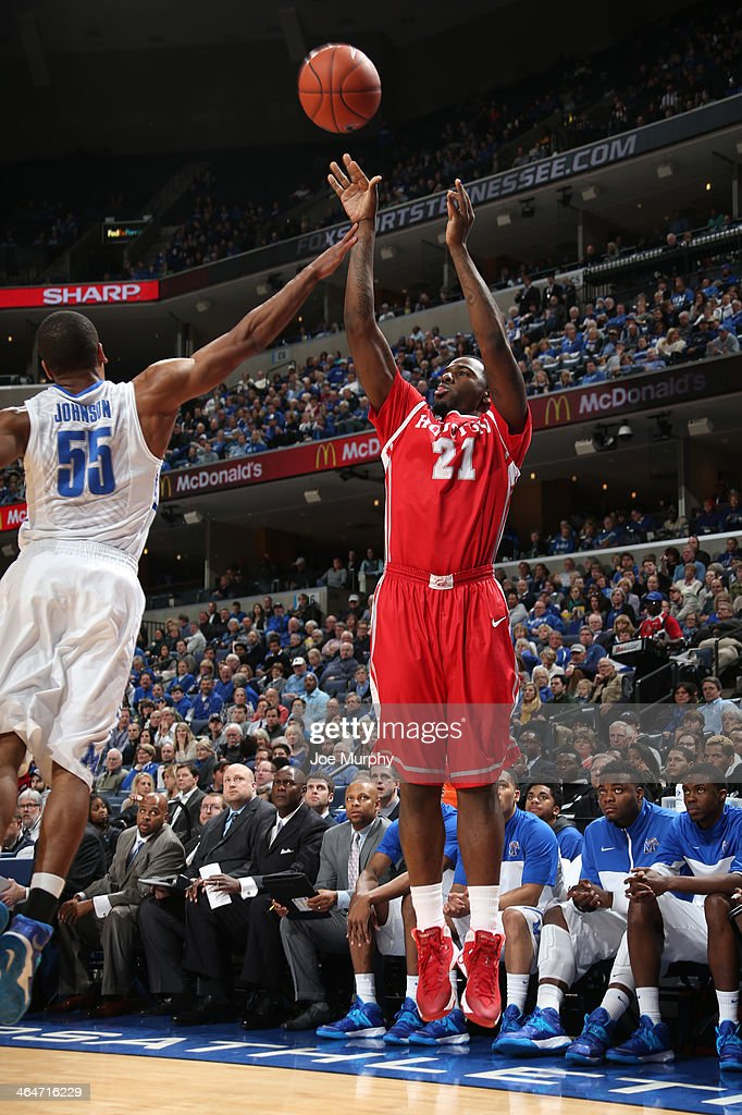 Jherrod Stiggers #21 of the Houston Cougars shoots against Geron Johnson #55 of the Memphis Tigers on January 23, 2014 at FedExForum in Memphis, Tennessee. Memphis beat Houston 82-59.