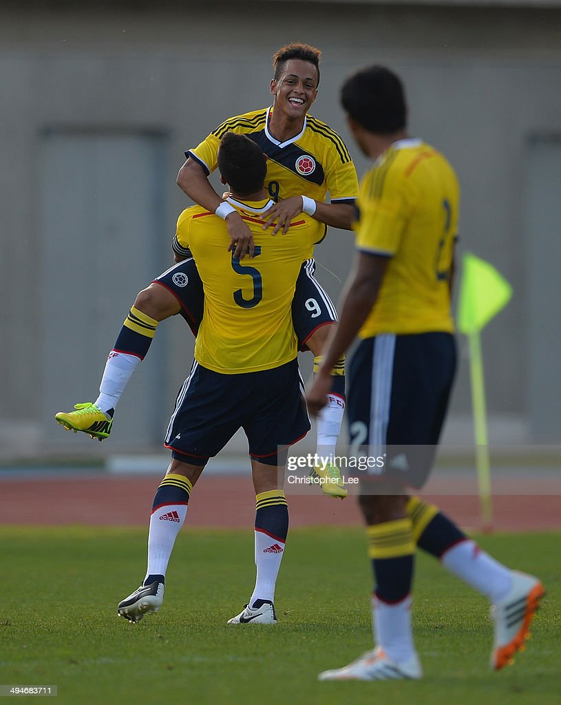 Jhoao Rodriguez of Colombia celebrates scoring their first goal with Juan Quintero during the Toulon Tournament Group B match between England and...