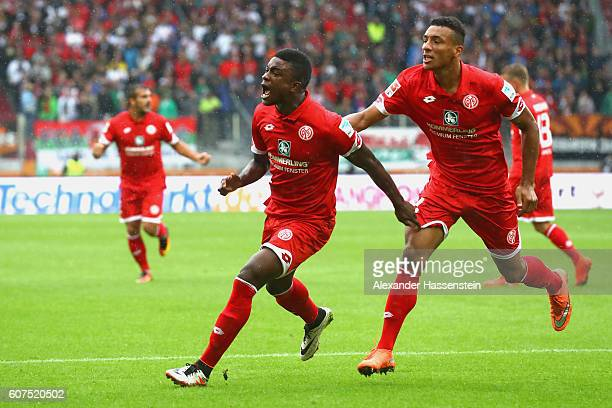 Jhon Andrés Córdoba Copete of Mainz celebrates scoring the opening goal with his team mate Karim Onisiwo during the Bundesliga match between FC...