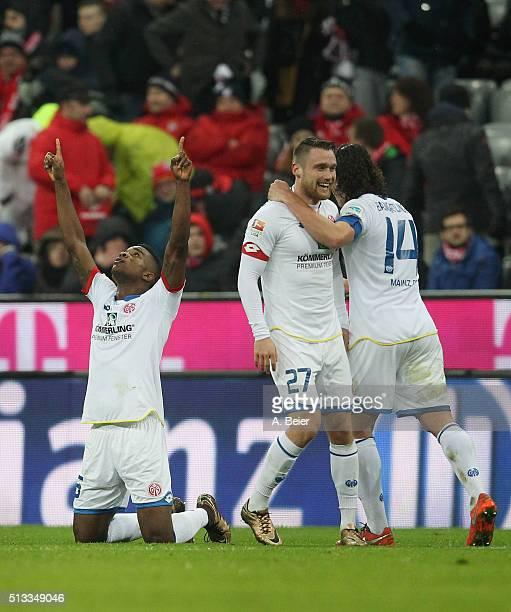 Jhon Cordoba Christian Clemens and Julian Baumgartlinger of Mainz 05 celebrate their team's victory after the Bundesliga match between FC Bayern...