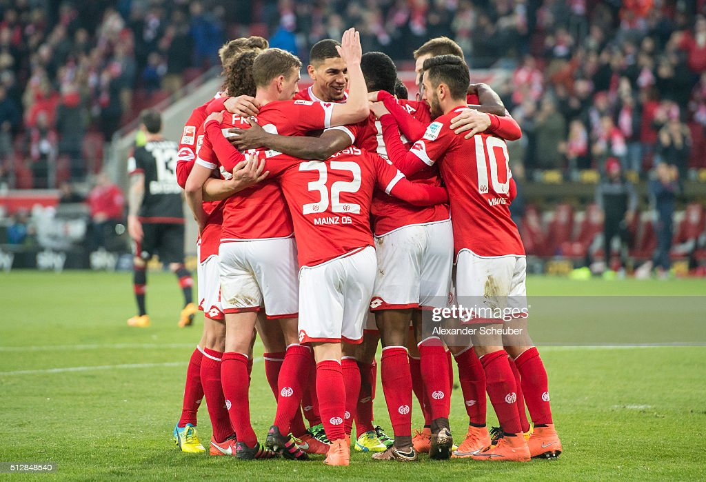 Jhon Cordoba of 1. FSV Mainz 05 celebrates the second goal for his team with Pablo de Blasis of 1. FSV Mainz 05, <a gi-track='captionPersonalityLinkClicked' href=/galleries/search?phrase=Yunus+Malli&family=editorial&specificpeople=5532598 ng-click='$event.stopPropagation()'>Yunus Malli</a> of 1. FSV Mainz 05 and Jairo Samperi of 1. FSV Mainz 05 during the Bundesliga match between 1. FSV Mainz 05 and Bayer Leverkusen at Coface Arena on February 28, 2016 in Mainz, Germany.