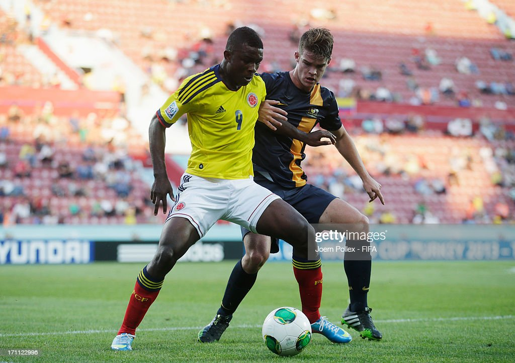 Jhon Cordoba (L) of Colombia and Connor Chapman of Australia compete for the ball during the FIFA U-20 World Cup Group C match between Colombia and Australia at Huseyin Avni Aker Stadium on June 22, 2013 in Trabzon, Turkey.