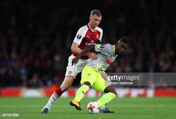Jhon Cordoba of FC Koeln and Per Mertesacker of Arsenal during the UEFA Europa League group H match between Arsenal FC and 1 FC Koeln at Emirates...
