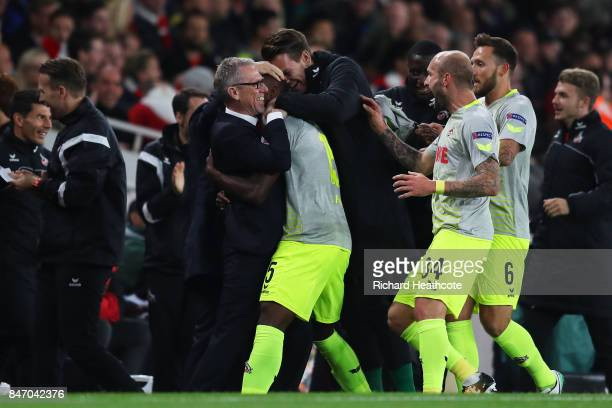 Jhon Cordoba of FC Koeln celebrates with Head Coach of FC Koeln Peter Stoger after scoring the first goal during the UEFA Europa League group H match...