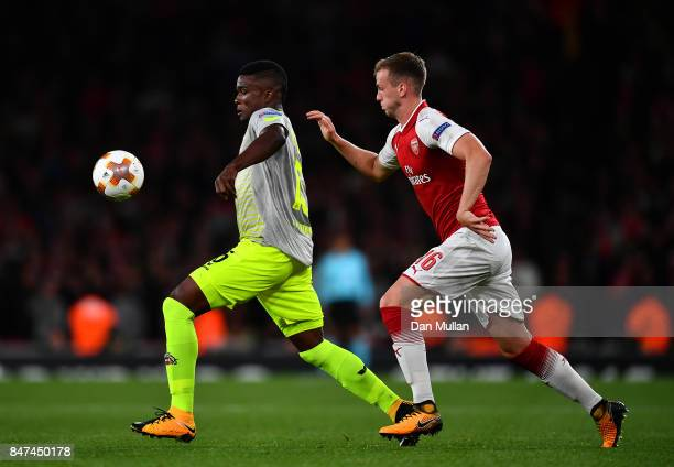 Jhon Cordoba of FC Koeln holds off Rob Holding of Arsenal during the UEFA Europa League group H match between Arsenal FC and 1 FC Koeln at Emirates...