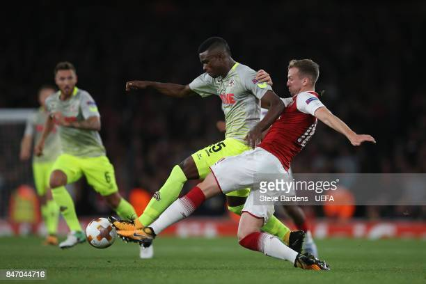 Jhon Cordoba of FC Koln is tackled by Rob Holding of Arsenal during the UEFA Europa League group H match between Arsenal FC and FC Koln at Emirates...