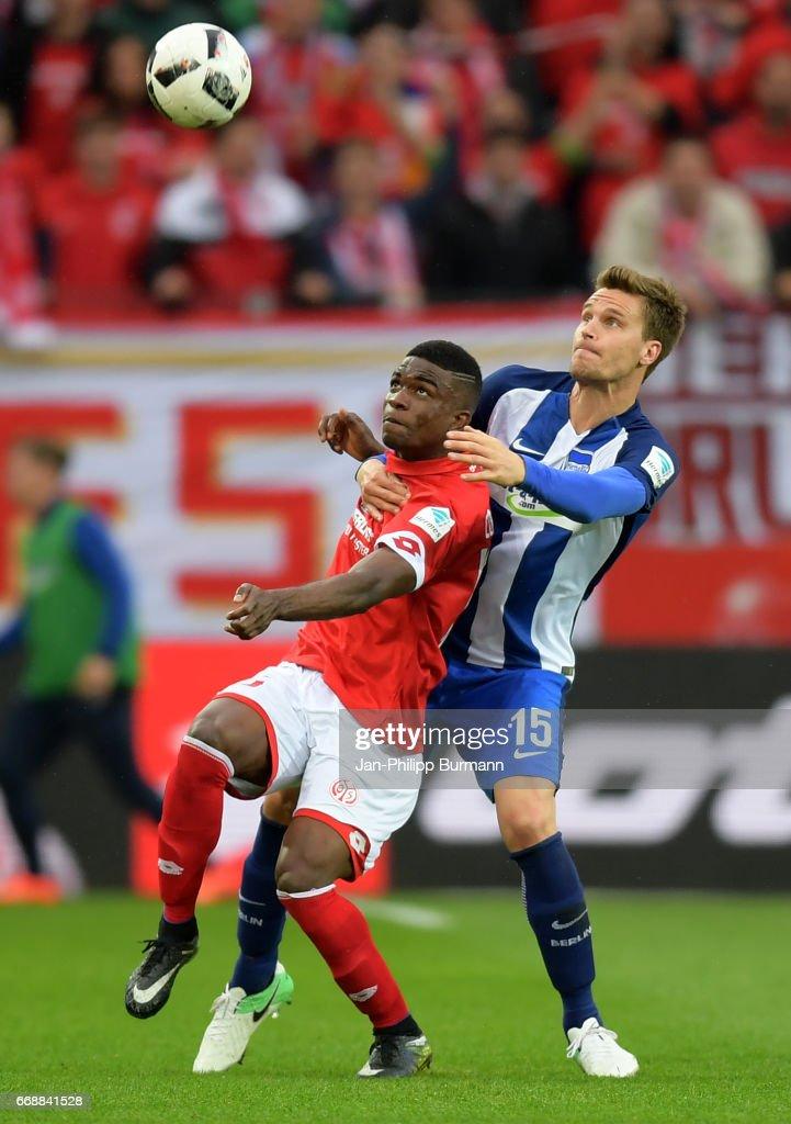 Jhon Cordoba of FSV Mainz 05 and Sebastian Langkamp of Hertha BSC during the game between FSV Mainz 05 and Hertha BSC on april 15, 2017 in Mainz, Germany.
