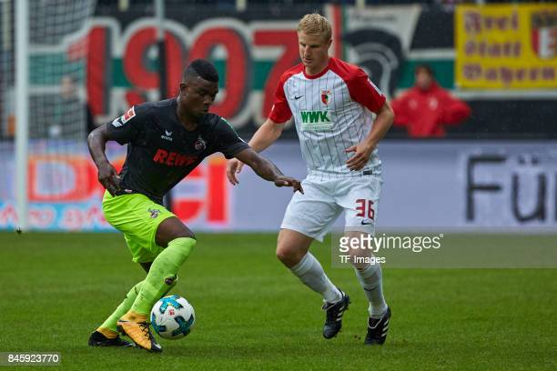 Jhon Cordoba of Koeln and Martin Hinteregger of Augsburg battle for the ball during the Bundesliga match between FC Augsburg and 1 FC Koeln at...