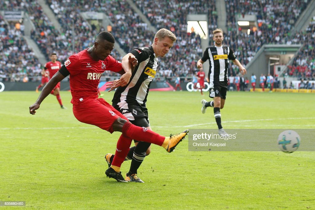 Jhon Cordoba of Koeln (l) and Matthias Ginter of Moenchengladbach during the Bundesliga match between Borussia Moenchengladbach and 1. FC Koeln at Borussia-Park on August 20, 2017 in Moenchengladbach, Germany.