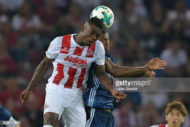 Jhon Cordoba of Koeln fight for the ball with Walace of Hamburg during the Bundesliga match between 1 FC Koeln and Hamburger SV at...
