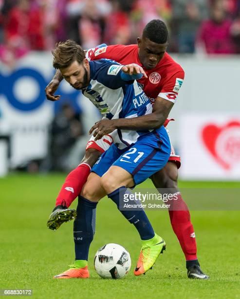 Jhon Cordoba of Mainz 05 challenges Marvin Plattenhardt of Hertha BSC during the Bundesliga match between 1 FSV Mainz 05 and Hertha BSC at Opel Arena...