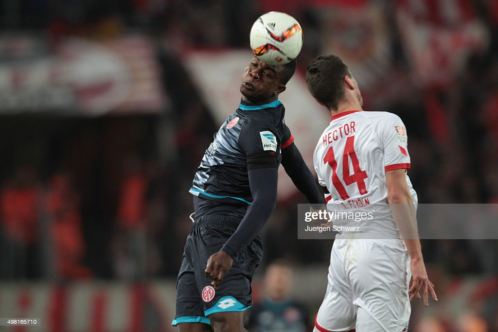 Jhon Cordoba of Mainz (L) and <a gi-track='captionPersonalityLinkClicked' href=/galleries/search?phrase=Jonas+Hector&family=editorial&specificpeople=8121522 ng-click='$event.stopPropagation()'>Jonas Hector</a> of Cologne jump for a header during the Bundesliga match between 1. FC Koeln and 1. FSV Mainz 05 at RheinEnergieStadion on November 21, 2015 in Cologne, Germany.