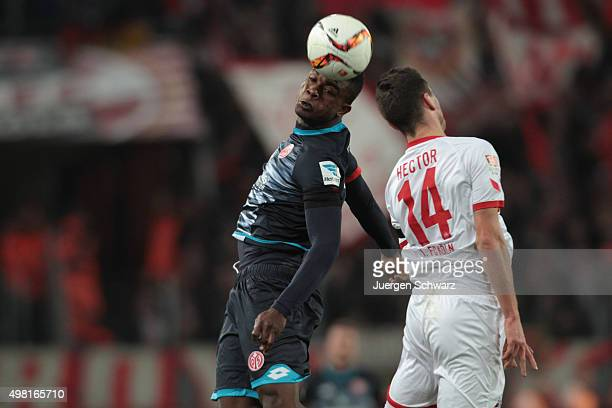 Jhon Cordoba of Mainz and Jonas Hector of Cologne jump for a header during the Bundesliga match between 1 FC Koeln and 1 FSV Mainz 05 at...