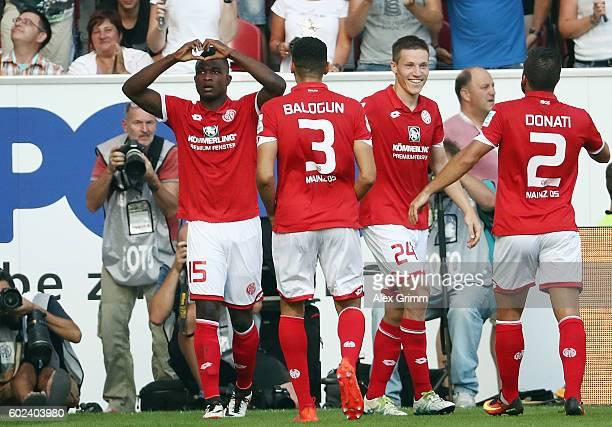 Jhon Cordoba of Mainz celebrates his team's third goal with team mates during the Bundesliga match between 1 FSV Mainz 05 and TSG 1899 Hoffenheim at...