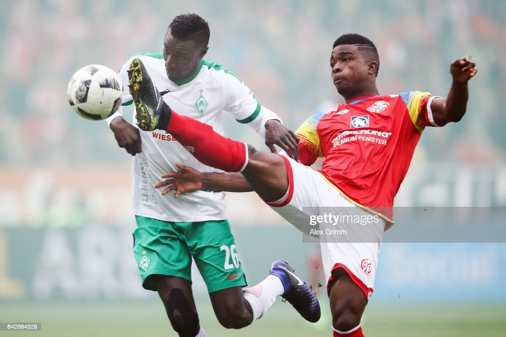 Jhon Cordoba (R) of Mainz is challenged by Ludovic Lamine Sane of Bremen during the Bundesliga match between 1. FSV Mainz 05 and Werder Bremen at Opel Arena on February 18, 2017 in Mainz, Germany.