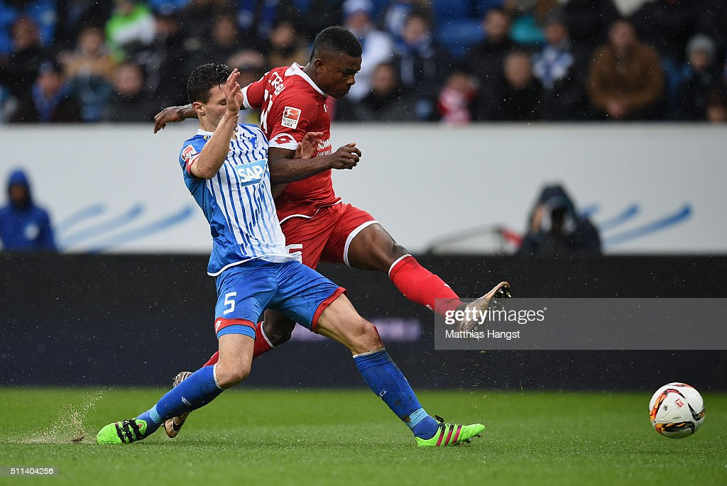 Jhon Cordoba of Mainz scores his team's first goal past Fabian Schaer of Hoffenheim during the Bundesliga match between 1899 Hoffenheim and 1. FSV Mainz 05 at Wirsol Rhein-Neckar-Arena on February 20, 2016 in Sinsheim, Germany.