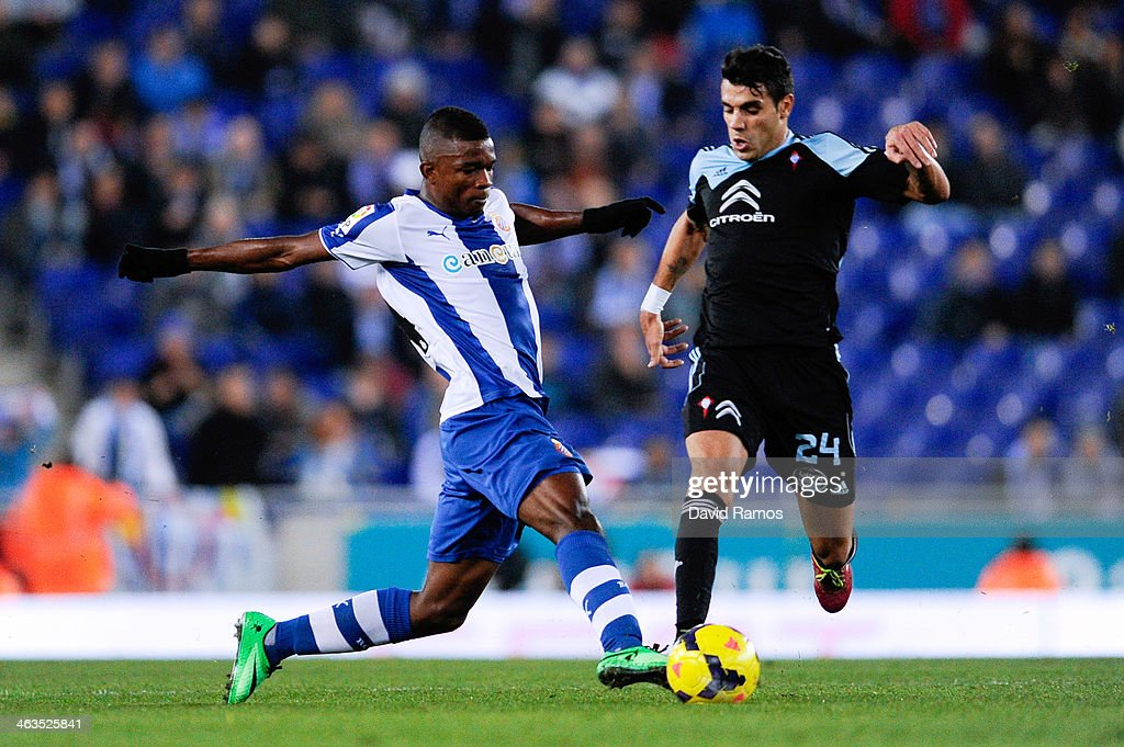 Jhon Cordoba (L) of RCD Espanyol duels for the ball with <a gi-track='captionPersonalityLinkClicked' href=/galleries/search?phrase=Augusto+Fernandez&family=editorial&specificpeople=684736 ng-click='$event.stopPropagation()'>Augusto Fernandez</a> of RC Celta de Vigo during the La Liga match between RCD Espanyol and RC Celta de Vigo at Cornella-El Prat Stadium on January 18, 2014 in Barcelona, Spain.