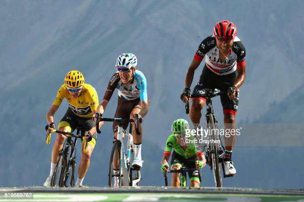 Jhon Darwin Atapuma Hurtado of Colombia riding for UAE Team Emirates leads Romain Bardet of France riding for AG2R La Mondiale and Christopher Froome...