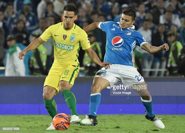Jhon Duque Arias of Millonarios fights for the ball with Diego Arias of Atletico Nacional during the Semi Finals first leg match between Millonarios...