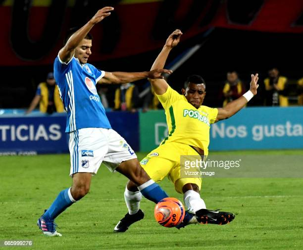 Jhon Duque of Millonarios vies for the ball with Farid Diaz player of Atletico Nacional during the match between Millonarios and Atletico Nacional as...