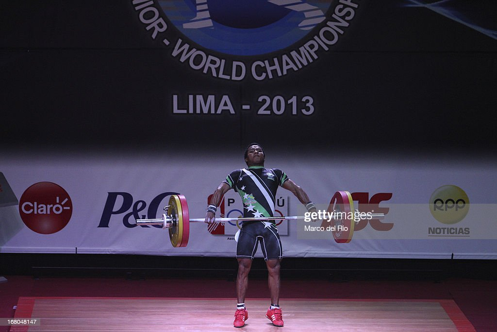 Jhon Jairo Serna Mendoza of Colombia A competes in the Men's 56kg during day one of the 2013 Junior Weightlifting World Championship at Maria Angola Convention Center on April 04, 2013 in Lima, Peru.