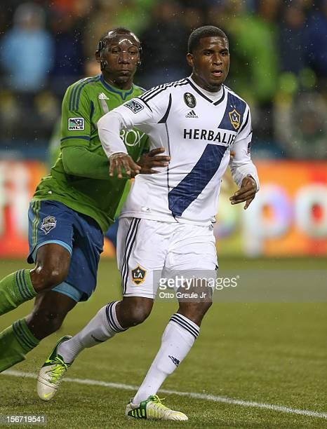 Jhon Kennedy Hurtado of the Seattle Sounders FC battles Edson Buddle of the Los Angeles Galaxy during Leg 2 of the Western Conference Championship at...