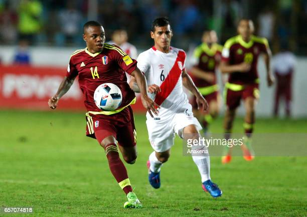 Jhon Murillo of Venezuela and Miguel Trauco of Peru run for the ball during a match between Venezuela and Peru as part of FIFA 2018 World Cup...