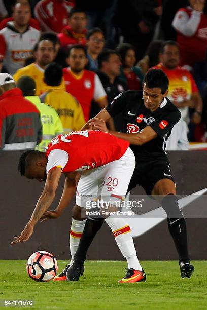 Jhon Pajoy of Santa Fe and Luis Cardozo of Libertad compete for the ball during a second leg match between Independiente Santa Fe and Libertad as...