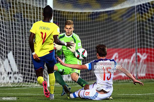 Jhon Pererira of Ecuador scores his team's third goal against goalkeeper Aleksandr Maksimenko and Semen Matviichuk of Russia during the FIFA U17...