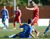 Jhon Perez of America de Cali fights for the ball with Luciano Ospina of Rionegro during a match between Rionegro a America de Cali as part of first...