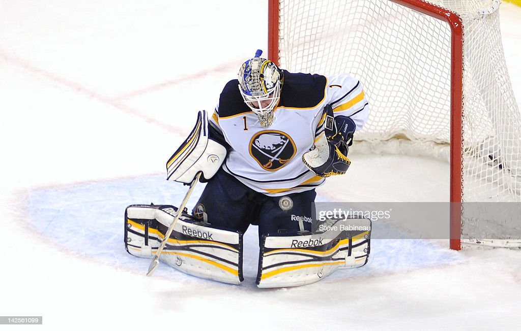 <a gi-track='captionPersonalityLinkClicked' href=/galleries/search?phrase=Jhonas+Enroth&family=editorial&specificpeople=570456 ng-click='$event.stopPropagation()'>Jhonas Enroth</a> #1 of the Boston Bruins makes a save against the Buffalo Sabres at the TD Garden on April 7, 2012 in Boston, Massachusetts.